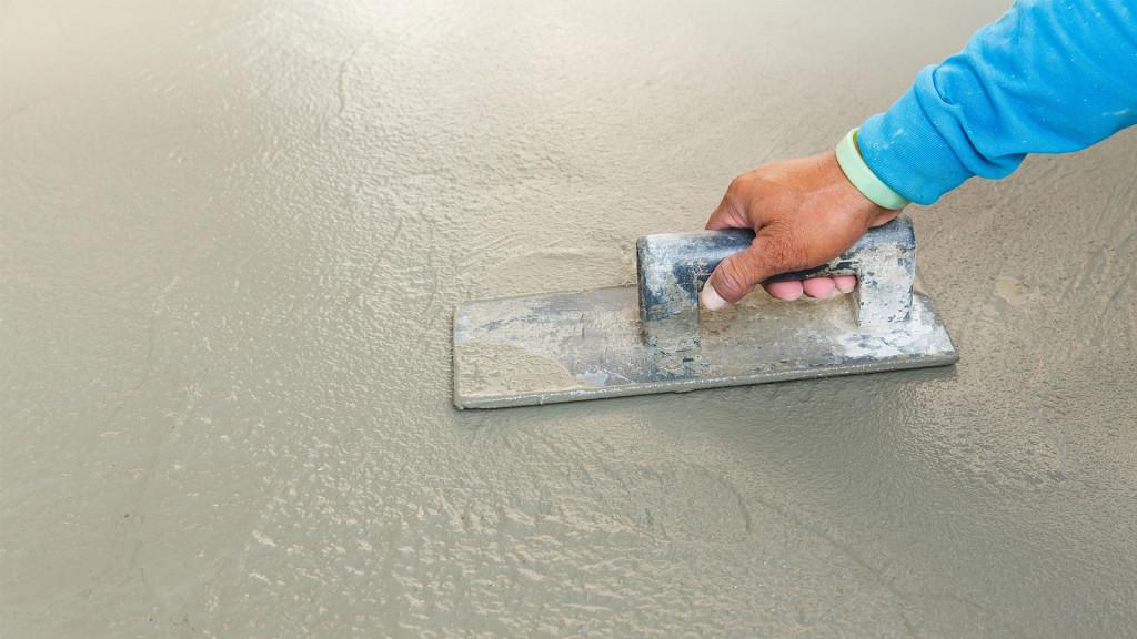 Finishing poured concrete, Cayman Concrete Pumping.